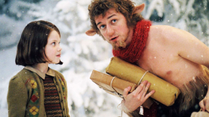 Georgie Henley as Lucy Pevensie with Mr. Tumnus the Faun in Disney's The Lion, The Witch, and The Wardrobe, 2005 Photo Credit: Narnia Wikia
