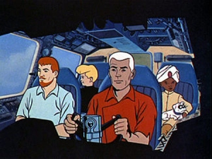 """The Quest team from the 1964-1965 television series. Front row (left to right): Dr. Benton Quest and Roger """"Race"""" Bannon. Back row: Jonny Quest, Hadji, and Bandit"""